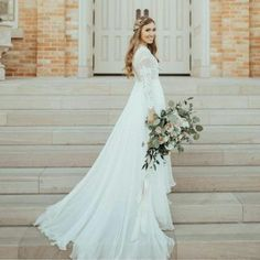 modest wedding dress with long lace sleeves from alta moda . . photo by calder photography