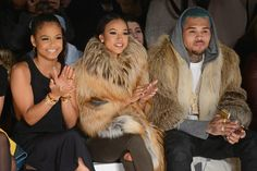 Karrueche Tran Photos - (L-R) Christina Milian, Karrueche Tran, and Chris Brown attend the Michael Costello fashion show during Mercedes-Benz Fashion Week Fall 2015 at The Salon at Lincoln Center on February 17, 2015 in New York City. - Michael Costello - Front Row - Mercedes-Benz Fashion Week Fall 2015