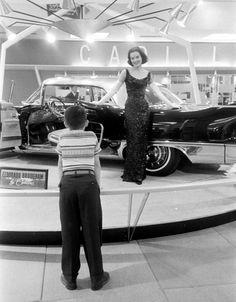 At a car show, 1957