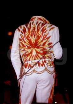 "IN THE LINE OF FIRE!!! a beautiful back view of THE FLAME JUMPSUIT. ELVIS wore it with the original ""Flame Belt"", aka the Centaur Flame Belt!"