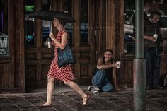 lady holding umbrella - all rights reserved to shadi dunkin a k s photography Red dress Man looking at the lady passing by holding a cup