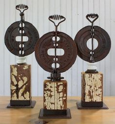 Rusty stuff. Love the old block idea for creating displays of antiques.