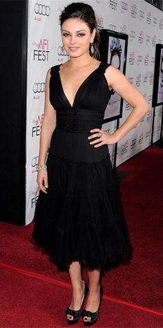 Mila kunis walking in a black dress