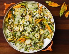 Learn to make a delicious summer salad that pairs charred corn and raw shaved summer squash, tossed with salty feta and smoky nigella seeds.