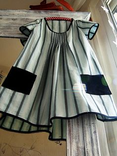 Could be a cute Oliver + S Family Reunion dress with stripes! I like the pockets.