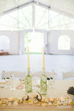 Real Wedding by Divine Weddings & Events - head table decor, candles in wine bottles, antlers, wooden table runner   Photo by Kamp Photography