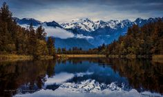 https://flic.kr/p/AGzyCz | Lake Matheson | Patience paid off, waited for the clouds to clear and luckily right before sunset they cleared for a few minutes and was able to capture this great reflection - South Island, New Zealand
