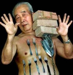 Call Me No Hands Jackson In This Photo: A Man balancing Forks and Bricks on his body