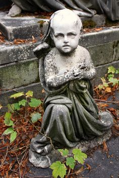 Forgotten Tomb Statue of a Baby Girl    Cimetiere du Pere Lachaise, Paris - France