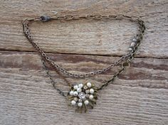 Pearl and Rhinestone Pin Necklace:  http://www.etsy.com/listing/98303274/sale-pearl-and-rhinestone-pin-necklace