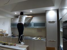 Installation of lighting system - Colella Interiors kitchen installation process