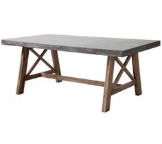 FORD DINING TABLE CEMENT & NATURAL The Ford Dining table is made from solid Acacia wood base finished in a contemporary dark walnut stain. The top is a non-porous epoxy and cement mix designed to be e