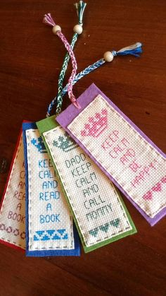 Cross stitch embroidered bookmarks sewn on felt Cross Stitch Bookmarks, Crochet Bookmarks, Cross Stitch Love, Cross Stitch Alphabet, Cross Stitch Designs, Cross Stitch Patterns, Felt Bookmark, Book Markers, Hand Embroidery Patterns