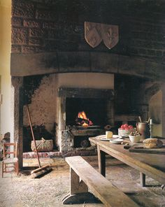 medieval era kitchen with wood fired oven.  This puts me in mind of the Kelly cottage.  Somewhat larger though, I think.  Yes, that's right.  This kitchen has more space than their whole cottage!