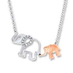 A baby elephant crafted of 10K rose gold holds his mama's tail in this whimsical necklace for her. Sparkling diamonds totaling 1/20 carat in weight decorate the sterling silver mother elephant to complete the look. The pendant suspends between an 18-inch rolo chain that secures with a spring ring clasp. Diamond Total Carat Weight may range from .04 - .06 carats.
