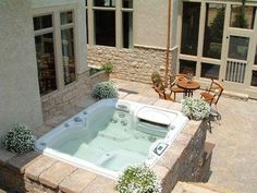 A spa was built using Weathered Mosaic in a blended color to match the natural stone of this home's exterior.