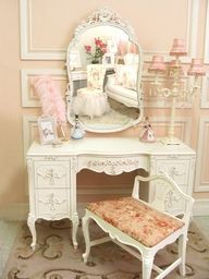 pink, cream, and white desk with scroll mirror