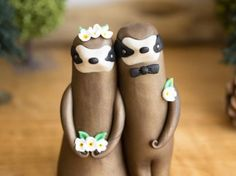 This Sloth Wedding Cake Topper features a pair of Sloths adorned with white flowers. The groom has wrapped one of his long arms around the the Wedding Cake Toppers, Wedding Cakes, Sloth Cakes, White Bow Tie, Two Brides, Polymer Clay Animals, Hand Designs, Clay Creations, Wedding Bells