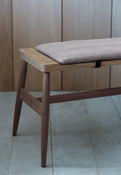 The Imo bench seats 3. Upholstered pad with leather fasteners optional.