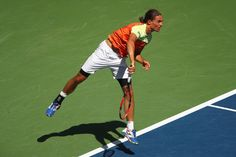 Alexandr Dolgopolov of Ukraine serves against Rafael Nadal of Spain during their fourth round Men's Singles match on Day Eight of the 2017 US Open at the USTA Billie Jean King National Tennis Center on September 4, 2017 in the Flushing neighborhood of the Queens borough of New York City.