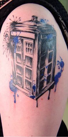 Black and gray TARDIS tattoo with splashes of TARDIS blue.