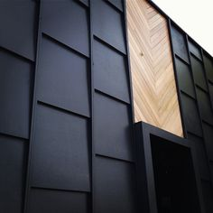 "In love with this all black + herringbone wood panel detail. #architecture #details  ALLEY-FACING WALL. THIS IS NEAT AND PROBABLY POSSIBLE. COULD DO THIS SAME PATTERN WITH A DETAIL AROUND THE DOOR AND WOOD ABOVE IT. I THOUGHT COULD BE COOL IF THE BLACK PANEL PARTS WERE HIGHER THAN THE MIDDLE WOOD PART, WOULD WOULD ""SPLIT"" THE HALFVES (GRANTED, THE DOOR WOULD NOT BE CENTERED LIKE IT IS - THAT WILL REMAIN WHERE IT IS CURRENTLY)"