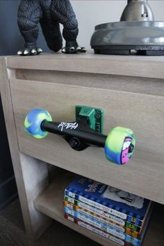 Recycled Skateboard Wheels Drawer Pull. What a cool idea for a teen boy bedroom!