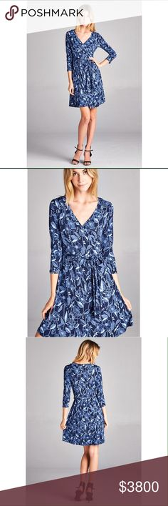 Stunning blue patterned dress 3/4 sleeves. Matching tie belt. 100% polyester. No trades. Dresses