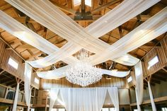 8 ft crystal chandelier at The Barn at Sycamore Farms in Arrington, TN. Draping by SouthernSKYTN.