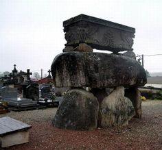 Unusual grave - a sarcophagus sits atop boulders.