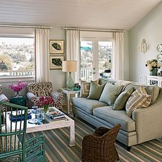 This stylish shed-turned-living room incorporates an earthy color palette using stripes.