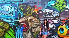 Adalid poses in front of graffiti art in her home country, the Philippines (Credit: Credit: Aileen Adalid)