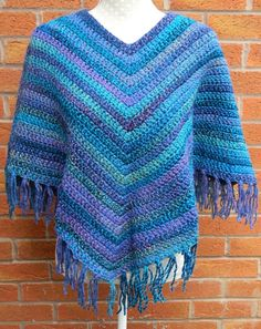 Crocheted Poncho in blue