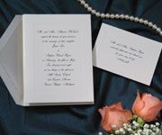 T 303  price per 100: $79.90  A simple embossed panel on soft white vellum gives this invitation a traditional look.