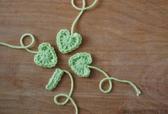 Crochet Shamrocks - Think Crafts by CreateForLess...hearts join to make the shamrock....free pattern!