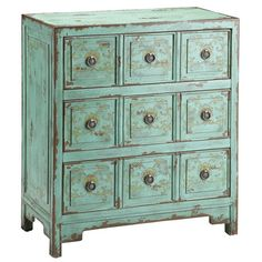Hand-painted chest with three drawers and faux apothecary-style facings.    Product: ChestConstruction Material: Wo...