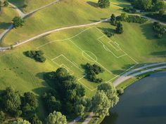 A pretty uncommon soccer field in Munich's Olympiapark.  If I remember right, a commercial was filmed there.    What you see is part of the Olympiaberg (Olympic Mountain) which is constituted mainly out of debris from the Second World War. It is now par This is cool!