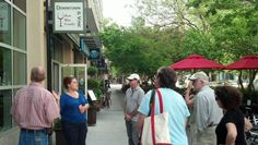 Tour guide Ashley teaching about all the delicious places to visit on K st!