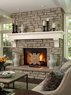 Stone fireplace...love the chunky white mantle