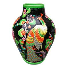 """""""Paon et fleurs"""" by Charles Catteau  France  c.1920's  Absolutely stunning, very rare peacock and floral vase with rich deep colors. Beautiful detail with shaded enamels. This vase is large and special. Signed KERAMIS MADE IN BELGIUM D.1859 Stamped 909"""