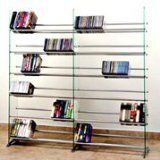 This sleek & contemporary designed glass multimedia rack compliments any room decor. Display your CD/DVD collections in a very unique way. Features: Accommodate 792 CDs or 552 DVDs or 324 VHS or any of the combination; Clear tempered safety glass panels with beveled edges; 12 fixed metal rod... more details available at https://furniture.bestselleroutlets.com/game-recreation-room-furniture/tv-media-furniture/media-storage/product-review-for-transdeco-glass-multimedia-cd-d