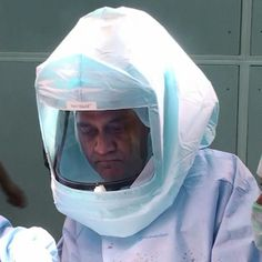 Attired in protective gear for a computer assisted knee replacement in Chennai . www.kneeindia.com