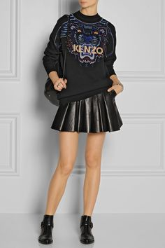 KENZO | Tiger-embroidered cotton sweater | Alexander Wang | Pleated leather mini skirt | Alexander Wang | Monk-strap leather ankle boots | Elizabeth and James | Sling textured-leather backpack | Eddie Borgo | Rhodium-plated cone bracelet | Maria Black | Double Harper oxidized silver two-finger ring |