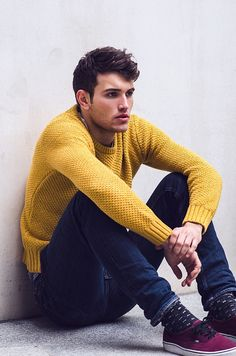 Gents, don't be afraid to play with color! Pair a bright fall-tone sweater with dark denim and shoes in a complementary tone.