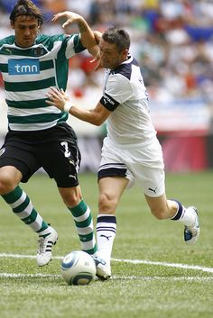 Tottenham Hotspur v Sporting Lisbon. Robbie Keane battles with Marco Torsiglieri, 25/7/2010.