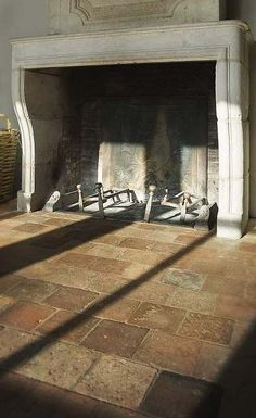 Stone fireplace surround and trumeau, reclaimed terracotta tiles via Antiek Amber, as seen on linenandlavender.net