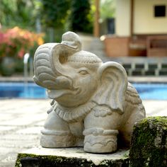 @Overstock - Color: Stone Washed  Materials: Volcanic ash and cement  Weight: 11 poundshttp://www.overstock.com/Worldstock-Fair-Trade/Small-Stone-Elephant-Statuette-Indonesia/6355614/product.html?CID=214117 $33.49