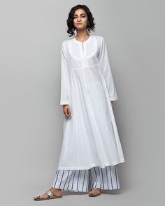 Tisya Plain Kurta from Women collection at Nicobar. Nicobar is for modern consumers who seek connection with things they acquire. Indian Attire, Indian Wear, Kurta Patterns, Kurta Style, Kurta Designs Women, Plain Kurti Designs, Tunics Online, Indian Designer Outfits, Designer Kurtas For Women