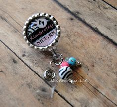 I love this!!  The little baubles are so cute!  ---------------------------- CUSTOM Name Badge reel - Zebra print blue and pink with baby feet. $7.00, via Etsy.