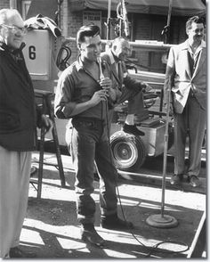 Elvis address' the cast and crew on the set of Loving You. Though he hated wearing denim, nevertheless, he's become a denim icon – that denim jacket and jeans did fit him quite well!